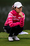Yanyan Hu of China lines up a putt during the Hyundai China Ladies Open 2014 on December 12 2014 at Mission Hills Shenzhen, in Shenzhen, China. Photo by Li Man Yuen / Power Sport Images
