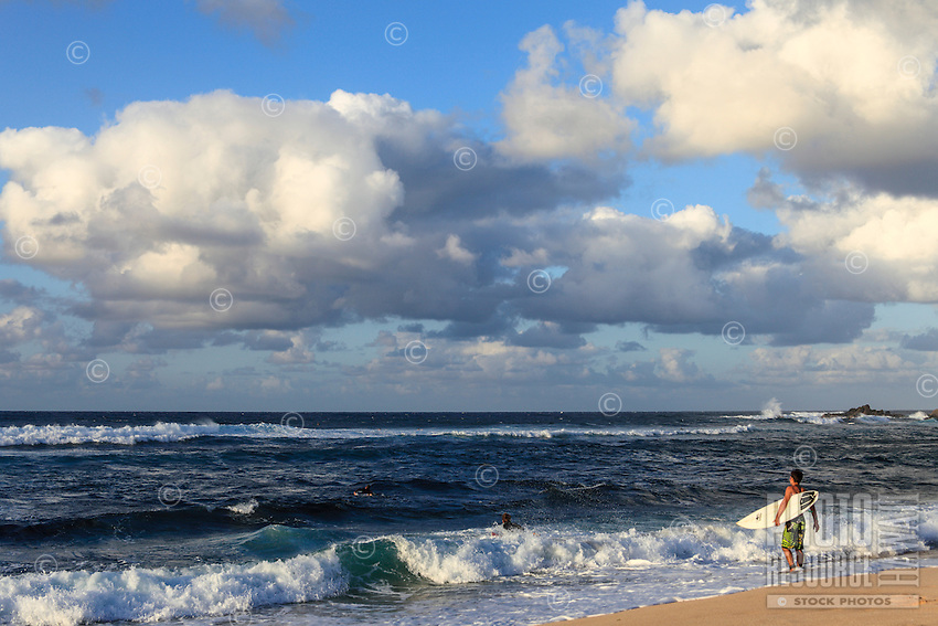 Surfers at Ho'okipa Beach, Maui.
