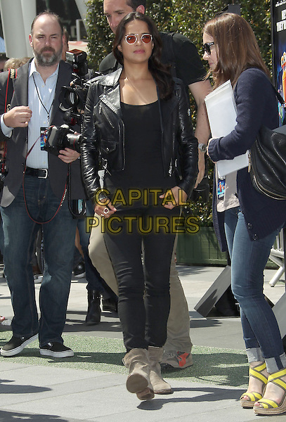 Michelle Rodriguez<br /> &quot;Turbo&quot; Party And Pop-Up Concert During E3 Gaming Convention held at Nokia Theatre L.A. Live, Los Angeles, California, USA.<br /> June 12th, 2013<br /> full length top leather jacket black sunglasses shades jeans denim ankle boots beige  <br /> CAP/ADM/RE<br /> &copy;Russ Elliot/AdMedia/Capital Pictures