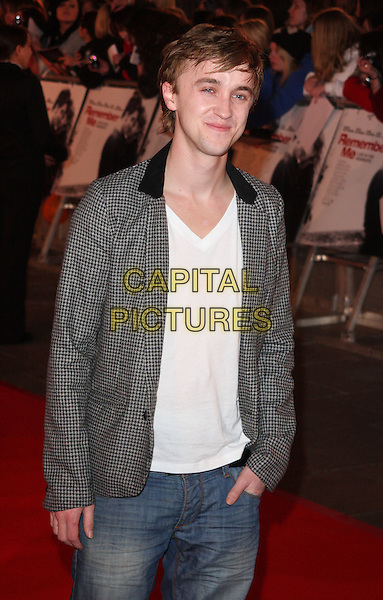 TOM FELTON.UK Premiere of 'Remember Me' held at the Odeon Leicester Square, London, England..March 17th 2010.half length grey gray jacket jeans white t-shirt checked check gingham denim v-neck hand in pocket.CAP/ROS.©Steve Ross/Capital Pictures.