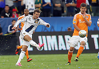 CARSON, CA - DECEMBER 01, 2012:   David Beckham (23) of the Los Angeles Galaxy blasts a shot past Bobby Boswell (32) of the Houston Dynamo during the 2012 MLS Cup at the Home Depot Center, in Carson, California on December 01, 2012. The Galaxy won 3-1.
