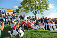 Team USA waits for Phil's birdie attempt to win the match during round 2 Four-Ball of the 2017 President's Cup, Liberty National Golf Club, Jersey City, New Jersey, USA. 9/29/2017.<br /> Picture: Golffile | Ken Murray<br /> <br /> All photo usage must carry mandatory copyright credit (&copy; Golffile | Ken Murray)