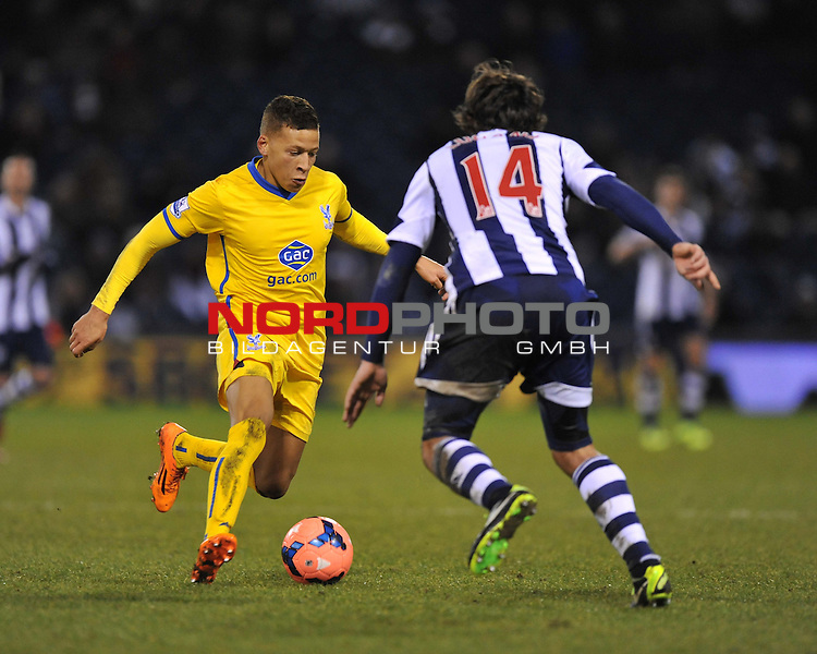 Crystal Palace's Dwight Gayle takes on West Bromwich Albion's Diego Lugano -  04/01/2014 - SPORT - FOOTBALL - West Bromwich - The Hawthorns - West Brom v Crystal Palace - FA Cup - Third Round<br /> Foto nph / Meredith<br /> <br /> ***** OUT OF UK *****