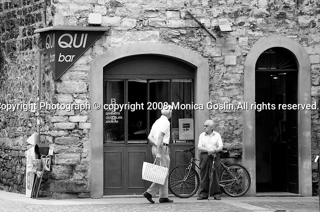 Black and white photograph of two men outside a bar in Como, Italy.