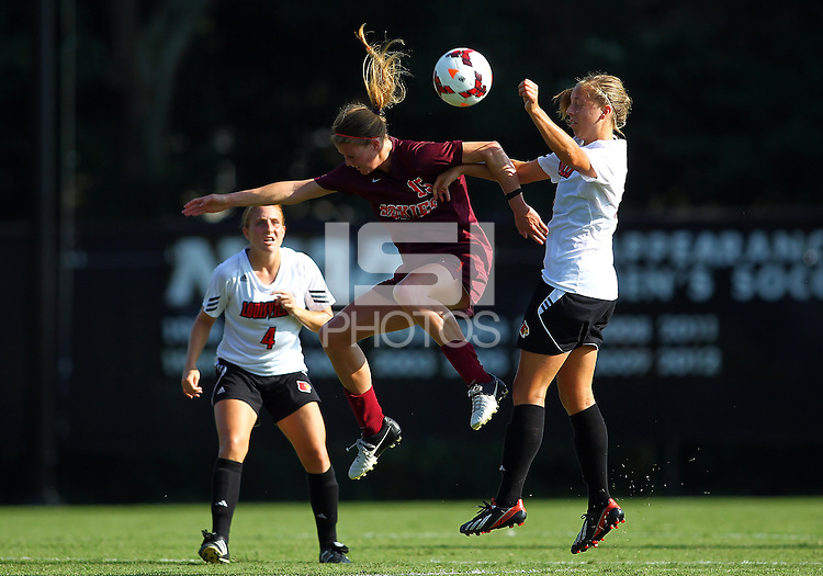 WINSTON-SALEM, NORTH CAROLINA - August 30, 2013:<br /> Nicole Gerber (18) of Louisville University defends against Ashley Meier (15) of Virginia Tech during a match at the Wake Forest Invitational tournament at Wake Forest University on August 30. The game ended in a 1-1 tie.