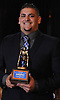 Gaetano Famiglietti of Glen Cove poses for a picture after receiving the Piner Award for most outstanding linebacker at the Nassau County High School Football Coaches Association Gridiron Banquet at Crest Hollow Country Club on Wednesday, Dec. 9, 2015.