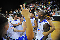 Saints players celebrate winning the national basketball league final between Wellington Saints and Bay Hawks at TSB Bank Arena, Wellington, New Zealand on Saturday, 5 July 2014. Photo: Dave Lintott / lintottphoto.co.nz