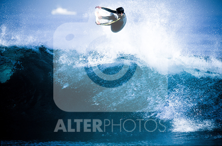A surfer busts a huge air over the lip of a wave off the coast of Newport Beach, california, EXPA Pictures © 2010, PhotoCredit: EXPA/ New Sport/ Les Walker *** ATTENTION *** United States of America OUT!