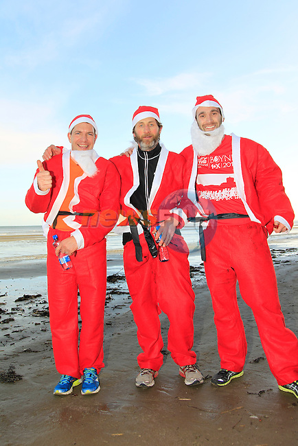 John Hough (3rd), John Cooper (1st) and Paul Filipiak (2nd) during The Great Santa 3k and Santa's little helpers run in Bettystown on Sunday 7th December 2014.<br /> Picture:  Thos Caffrey / www.newsfile.ie