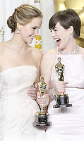 02/24/13 Hollywood, CA: Best Actress Jennifer Lawrence and Best Supporting Actress Anne Hathaway backstage posing with their Oscars