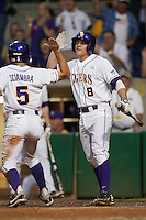 LSU Tigers first baseman Mason Katz #8 greets teammate Chris Sciambra #5 after he scores a first inning run Mississippi State Bulldogs during the NCAA baseball game on March 16, 2012 at Alex Box Stadium in Baton Rouge, Louisiana. LSU defeated Mississippi State 3-2 in 10 innings. (Andrew Woolley / Four Seam Images).