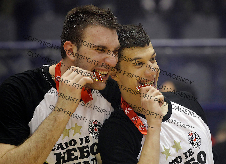 Kosarka, play off final match four 4<br /> Agroziv Superliga season 2012-2013<br /> Partizan Crvena Zvezda<br /> Vladimi Lucic right and KK Partizan players celebrate Serbia's championship title slave titulu sampiona Srbije Dejan Musli and Vladimir Lucic<br /> Belgrade, 06.12.2013.<br /> foto: Srdjan Stevanovic/Starsportphoto &copy;