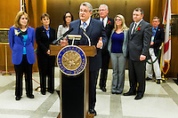 TALLAHASSEE, FLA. 3/4/14-Senate President Don Gaetz, R-Niceville, is flanked by Senators and advocates after the Senate passed a package of bills to strengthen laws against sex offenders during opening day of the legislative session, March 4, 2014 at the Capitol in Tallahassee. <br /> <br /> COLIN HACKLEY PHOTO