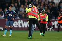 A pitch invader is caught by a steward during West Ham United vs Tottenham Hotspur, Caraboa Cup Football at The London Stadium on 31st October 2018