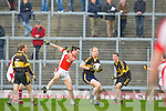 Seamus Scanlon Currow starts an attack despite Donal O'Sullivan Rathmore attentions during their O'Donoghue cup semi final in Fitzgerald Stadium on Sunday