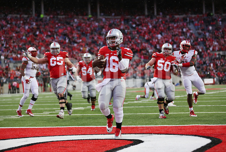 Ohio State Buckeyes quarterback J.T. Barrett (16) scores for a second time in the third quarter of an NCAA college football game between The Ohio State Buckeyes and the Rutgers Scarlet Knights at Ohio Stadium on Saturday, October 18, 2014.  (Columbus Dispatch photo by Fred Squillante)