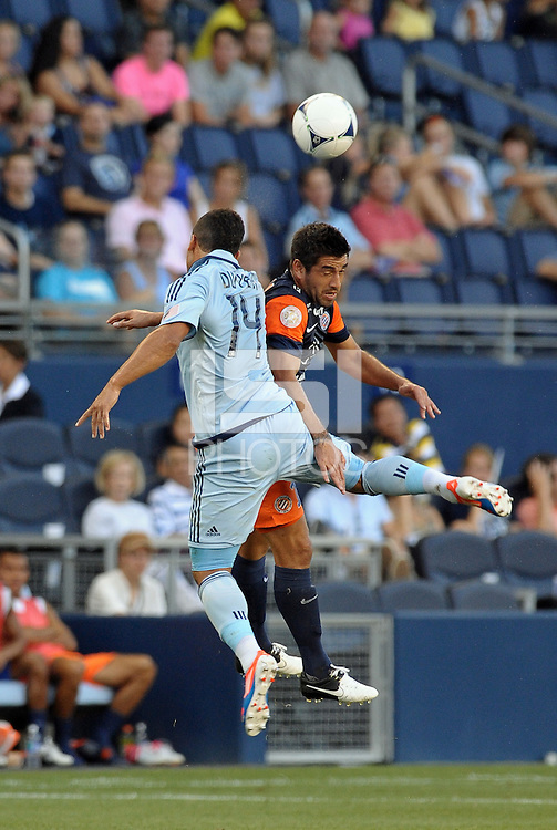 Dom Dwyer (14) forward Sporting KC and Marco Estrada (13) midfield Montpellier go up for a header..Sporting Kansas City were defeated 3-0 by Montpellier HSC in an international friendly at LIVESTRONG Sporting Park, Kansas City, KS..