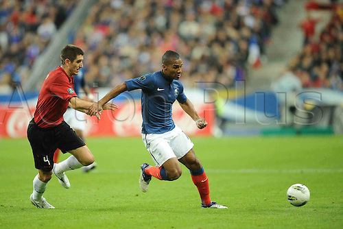 07 10 2011 France versus Albania Euro 2012 Football qualification match. Florent Malouda France is challenged by Armend Dallku Albania.