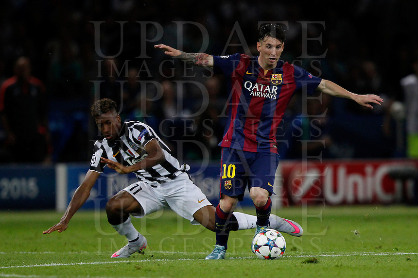 Calcio, finale di Champions League Juventus vs Barcellona all'Olympiastadion di Berlino, 6 giugno 2015.<br /> FC Barcelona's Lionel Messi, right, is challenged by Juventus' Kingsley Coman during the Champions League football final between Juventus Turin and FC Barcelona, at Berlin's Olympiastadion, 6 June 2015. Barcelona won 3-1.<br /> UPDATE IMAGES PRESS/Isabella Bonotto