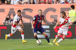 Rayo Vallecano´s Aquyino (L) and Tito and Barcelona´s Iniesta during La Liga match between Rayo Vallecano and Barcelona at Vallecas stadium in Madrid, Spain. October 04, 2014. (ALTERPHOTOS/Victor Blanco)