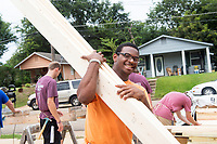 Service Dawgs volunteers working on the Habitat for Humanity house<br />