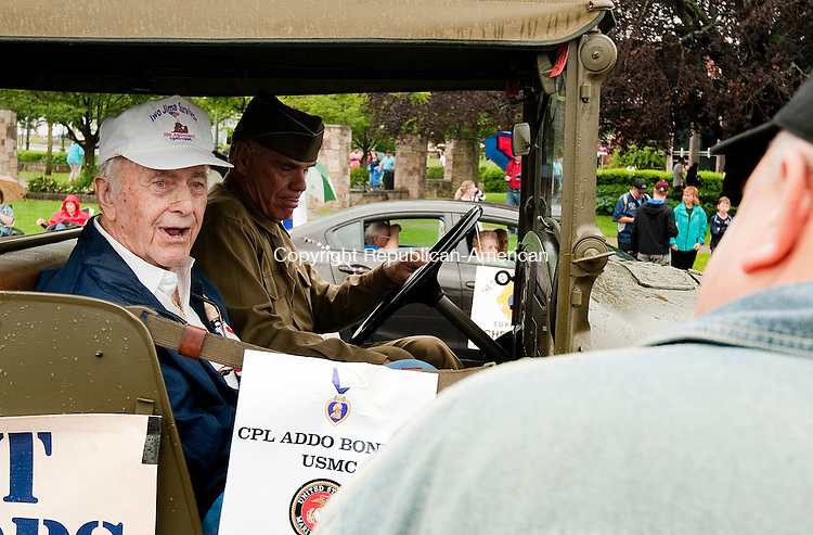 TORRINGTON,  CT--- -053016JS02- Iwo Jima survivor and Purple Heart recipient Addo Bonetti, 90, of Torrington, talks with a parade a man who wanted to thank him for his service prior to the annual Torrington Memorial Day parade on Monday. <br />  Jim Shannon Republican-American
