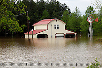 A home off of Highway B sits in flooded water in Poplar Bluff, MO on Wednesday, April 27, 2011. By Wednesday night, official water levels in Poplar Bluff had reached to 19.54 feet.