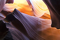 Turbulent waves of colorful multi hued desert landscape which were created by natural forces of erosion are unique to the Antelope slot canyon in the Colorado Plateau near Page and Lake Powell in Arizona