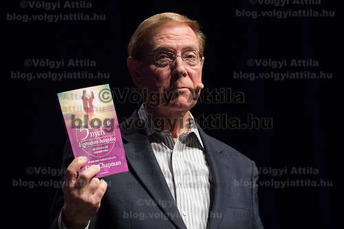 Dr. Gary Chapman psychologist and author best known for his 5 love languages books holds his book translated into Hungarian during a lecture in Budapest, Hungary on March 31, 2017. ATTILA VOLGYI