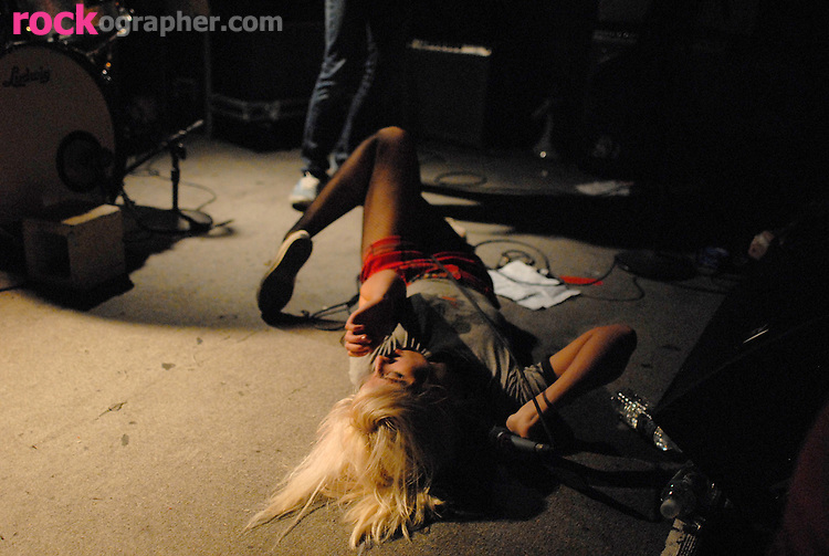 Singer Jemina Pearl  from Tennessee punk rock band 'Be Your Own Pet' sprawled out  on the stage at Maxwells , Hoboken NJ