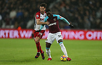 West Ham United's Arthur Masuaku and West Bromwich Albion's Jay Rodriguez<br /> <br /> Photographer Rob Newell/CameraSport<br /> <br /> The Premier League - West Ham United v West Bromwich Albion - Tuesday 2nd January 2018 - London Stadium - London<br /> <br /> World Copyright &copy; 2018 CameraSport. All rights reserved. 43 Linden Ave. Countesthorpe. Leicester. England. LE8 5PG - Tel: +44 (0) 116 277 4147 - admin@camerasport.com - www.camerasport.com