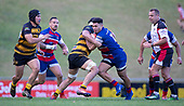 Joshua Gray takes on Tulele Masoe during the Counties Manukau Premier 1 McNamara Cup Final between Ardmore Marist and Bombay, played at Navigation Homes Stadium on Saturday July 20th 2019.<br />  Bombay won the McNamara Cup for the 5th time in 6 years, 33 - 18 after leading 14 - 10 at halftime.<br /> Photo by Richard Spranger.