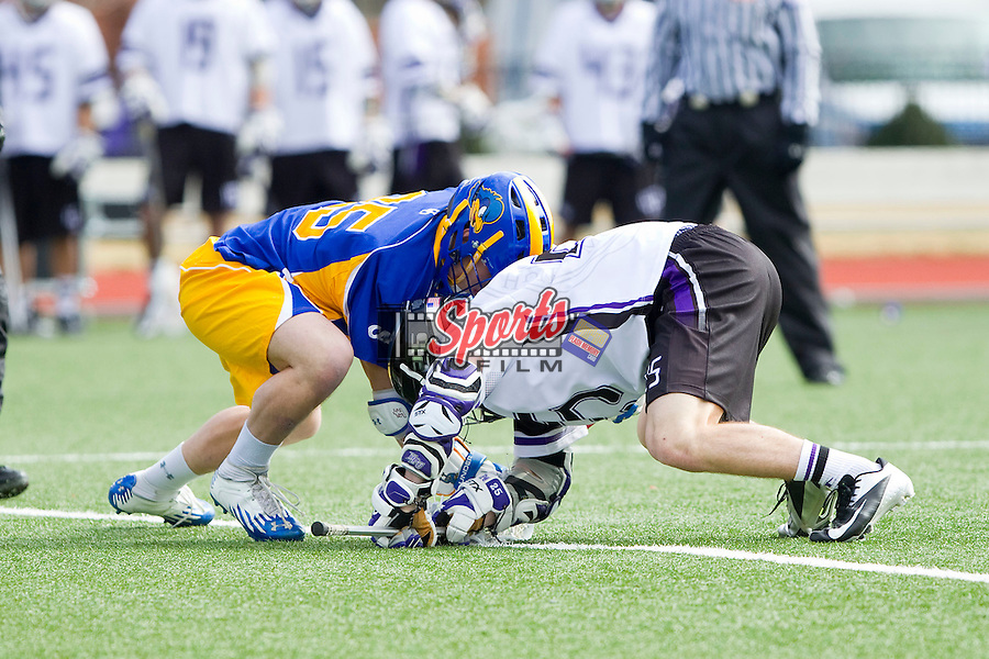 Jamie Piluso (25) of the High Point Panthers faces off against Tyler Barbarich (25) of the Delaware Blue Hens at Vert Track, Soccer & Lacrosse Stadium on February 2, 2013 in High Point, North Carolina.  The Blue Hens defeated the Panthers 12-10.   (Brian Westerholt/Sports On Film)