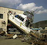 On March 11, 2011, earthquake of magnitude 9.0 and devastating tsunami hit the Tohoku area, killing more than 15,000 people and missing more than 5,000 people. A boat crashed into a building by tsunami.<br />