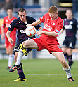 Raith's Jason Thomson holds off Partick's Stuart Bannigan ...