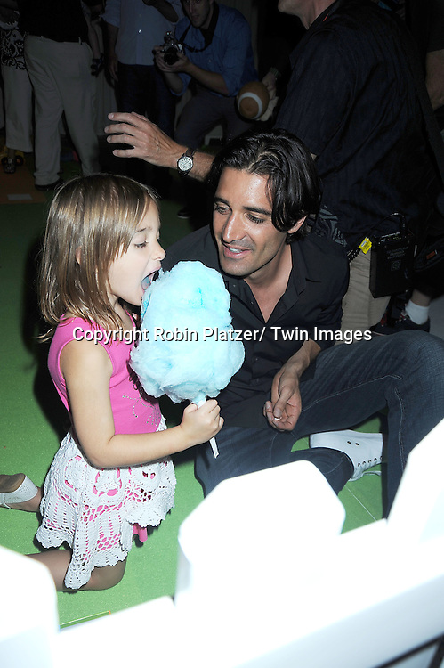 "Gilles Marini and daughter Juliana attending the kick-off of Father's Day week with  The Pampers with Dry Max Pays Homage to ""Dads on Diaper Duty""  event on June 17, 2010 at The Metropolitan Pavilion in New York City."