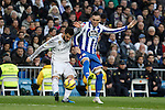 Real Madrid´s Nacho Fernandez (L) and Deportivo de la Courna´s Cavaleiro during La Liga match at Santiago Bernabeu stadium in Madrid, Spain. February 14, 2015. (ALTERPHOTOS/Victor Blanco)