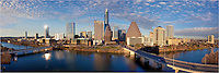 Beautiful view of the downtown Austin skyline in this panorama taken from high up on the Hyatt. Congress Bridge and First Street Bridge connect the land across Lady Bird Lake.