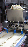 Pictured: Patries come out of a cutting machine. Friday 26 May 2017<br /> Re: Lewis Pie and Pasty Company which has gone into halal products in Swansea, Wales, UK