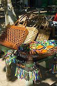 Praia da Concha, Itacare, Bahia State, Brazil. Beach seller's wares; baskets, purses, good luck ribbons, key rings.
