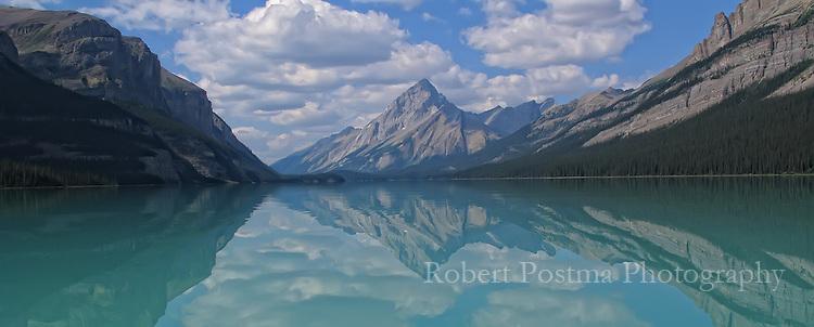 Reflection of Samson mountain in Maligne Lake, Jasper National Park, Alberta.