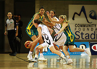 Ferns captain Toni Edmonton tries to get past Carly Wilson as Elizabeth Cambage and Kim Barnes look on during the International women's basketball match between NZ Tall Ferns and Australian Opals at Te Rauparaha Stadium, Porirua, Wellington, New Zealand on Monday 31 August 2009. Photo: Dave Lintott / lintottphoto.co.nz