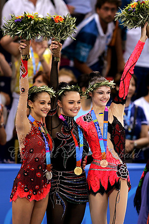 August 29, 2004; Athens, Greece; (L-R) Rhythmic gymnasts Irinia  Tchachina of Russia, Alina Kabaeva of Russia and Anna Bessonova of Ukraine won silver, gold, bronze respectively in All-Around at 2004 Athens Olympics..(©) Copyright 2004 Tom Theobald