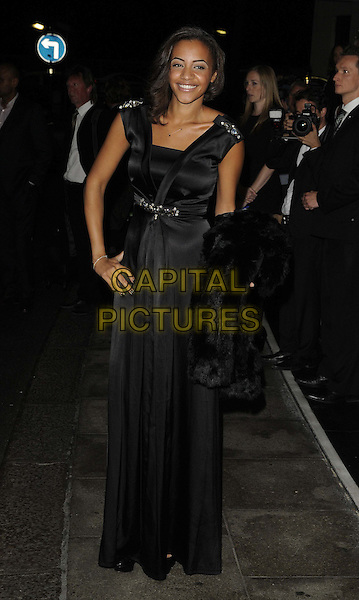 Amal Fashanu.The Fashion for the Brave fundraising event inn aid of the British Forces Foundation & the Household Cavalry Operational Casualties Fund, Dorchester Hotel, London, England..September 20th, 2012.full length black silk satin dress hand on hip.CAP/CAN.©Can Nguyen/Capital Pictures.