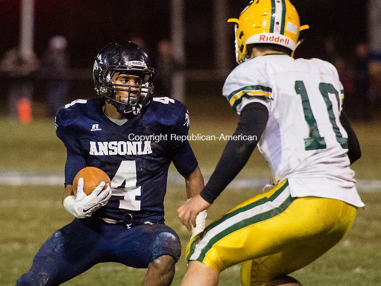 ANSONIA, CT - 7 December 2015-120715EC06-- Ansonia's Tajik Bagley faces Trinity Catholic's Nick Granata Monday night at Ansonia. Erin Covey Republican-American.
