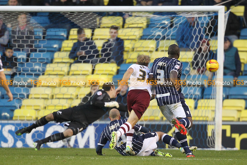 Scott Arfield of Burnley sees his shot hit the post - Millwall vs Burnley - Sky Bet Championship Football at the New Den, Bermondsey, London - 02/11/13 - MANDATORY CREDIT: Simon Roe/TGSPHOTO - Self billing applies where appropriate - 0845 094 6026 - contact@tgsphoto.co.uk - NO UNPAID USE