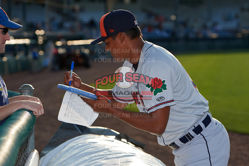 Connecticut Tigers pitcher Ken Figueroa (52) signs autographs for fans during a game against the Auburn Doubledays on August 10, 2017 at Falcon Park in Auburn, New York.  Connecticut defeated Auburn 4-1.  (Mike Janes/Four Seam Images)