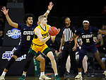 SIOUX FALLS, SD - MARCH 8: Sam Griesel #5 of the North Dakota State Bison passes the ball as Kevin Obanor #0 of the Oral Roberts Golden Eagles defends at the 2020 Summit League Basketball Championship in Sioux Falls, SD. (Photo by Richard Carlson/Inertia)