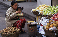 Woman and child eating at market