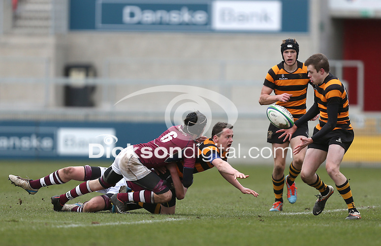 CAI vs RBAI | Tuesday 3rd March 2015<br /> <br /> Michael Lowry gets his off-load to Callum McLaughlin during the 2015 Ulster Schools Cup Semi-Final between Coleraine Inst and RBAI at the Kingspan Stadium, Ravenhill Park, Belfast, Northern Ireland.<br /> <br /> Picture credit: John Dickson / DICKSONDIGITAL